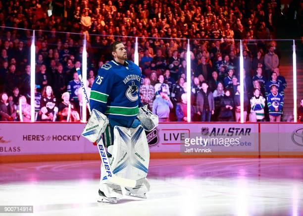 Anders Nilsson of the Vancouver Canucks listens to the national anthem during their NHL game against the Los Angeles Kings at Rogers Arena December...