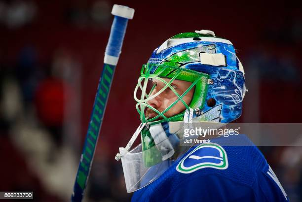Anders Nilsson of the Vancouver Canucks looks on from his crease during their NHL game against the Winnipeg Jets at Rogers Arena October 12 2017 in...