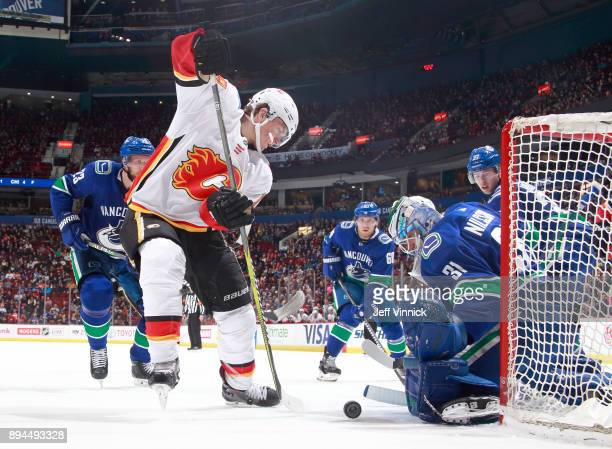 Anders Nilsson of the Vancouver Canucks makes a save off the shot of Matthew Tkachuk of the Calgary Flames during their NHL game at Rogers Arena...