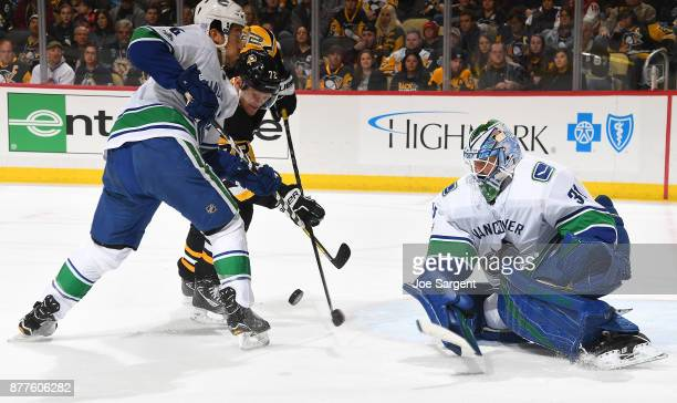 Anders Nilsson of the Vancouver Canucks protects the net against Patric Hornqvist of the Pittsburgh Penguins at PPG Paints Arena on November 22 2017...