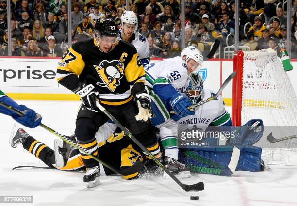 Anders Nilsson of the Vancouver Canucks protects the net against Sidney Crosby of the Pittsburgh Penguins at PPG Paints Arena on November 22 2017 in...