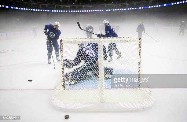 Anders Nilsson of the Vancouver Canucks reaches out to make a glove save during their practice at MercedesBenz Arena September 19 2017 in Shanghai...