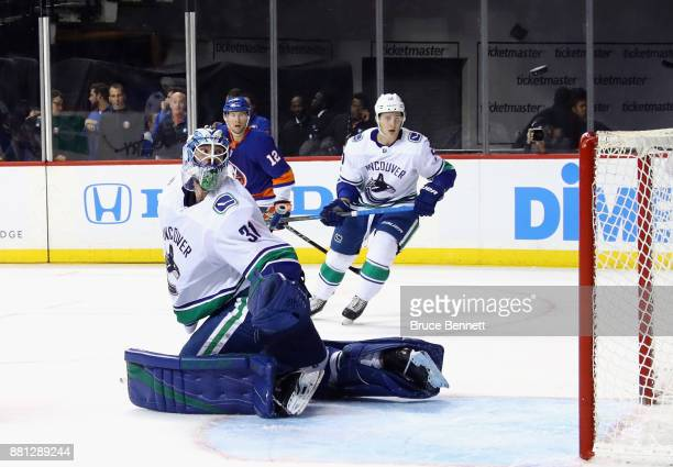Anders Nilsson of the Vancouver Canucks watches his deflected puck hit the top of the net during the second period against the New York Islanders at...
