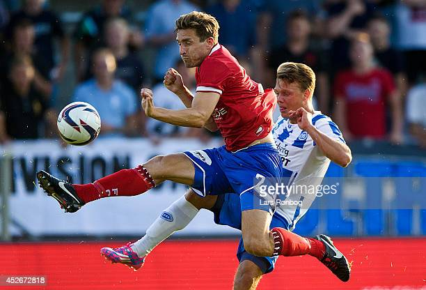 Anders Ostli of FC Vastsjalland and Emil Larsen of OB Odense compete for the ball during the Danish Superliga match between FC Vestsjalland and OB...
