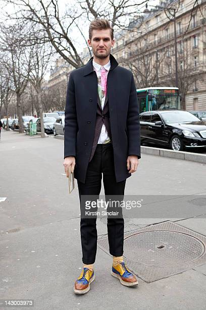 Anders Solvsten Thomsen Senior fashion editor at Love magazine wearing a Miu Miu coat Qasimi homme blazer Prada shoes marc jacobs trousers at Paris...