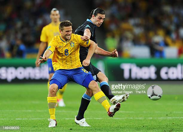 Anders Svensson of Sweden and Andy Carroll of England compete for the ball during the UEFA EURO 2012 group D match between Sweden and England at The...