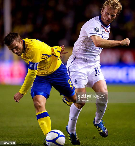Anders Svensson of Sweden and Dirk Kuyt of Holland during the EURO 2012 Qualifying match between Sweden and Netherlands at the Rasunda stadium on...