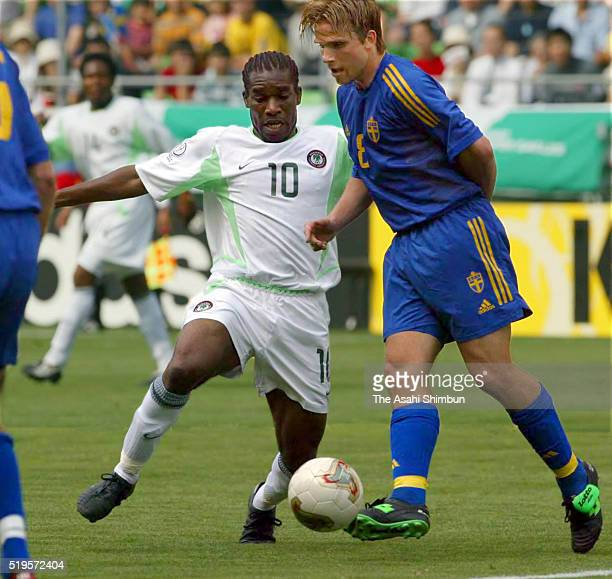 Anders Svensson of Sweden and JayJay Okocha of Nigeria compete for the ball during the FIFA World Cup Korea/Japan Group F match between Sweden and...