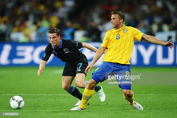 Anders Svensson of Sweden and Scott Parker of England compete for the ball during the UEFA EURO 2012 group D match between Sweden and England at The...