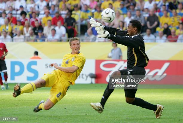 Anders Svensson of Sweden has a shot on goal as goalkeeper Shaka Hislop of Trinidad Tobago tries to block during the FIFA World Cup Germany 2006...