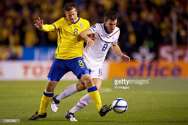 Anders Svensson of Sweden, Kevin Strootman of Holland during the EURO 2012 Qualifying match between Sweden and Netherlands at the Rasunda stadium on...