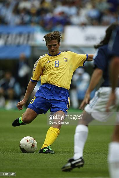 Anders Svensson of Sweden scores from a freekick during the Argentina v Sweden Group F World Cup Group Stage match played at the Miyagi Stadium...