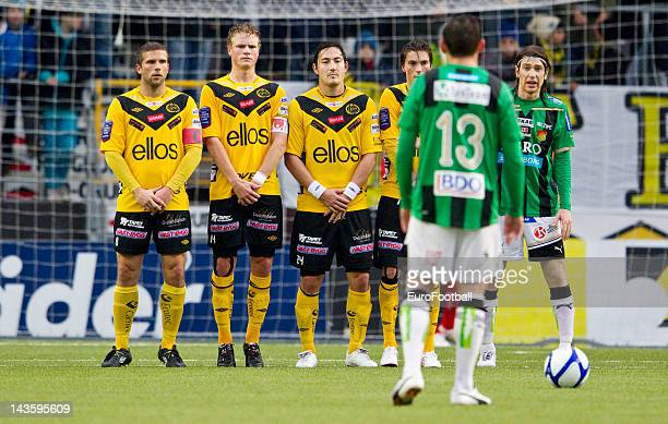 Anders Svensson Oscar Hiljemark and Stefan Ishizaki of IF Elfsborg line up to defend a free kick during the Swedish Allsvenskan League match between...