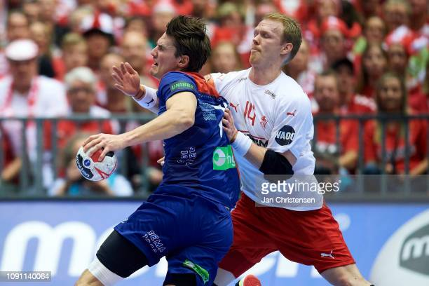 Anders Zachariassen of Denmark defend during the IHF Men's World Championships Handball Final between Denmark and Norway in Jyske Bank Boxen on...