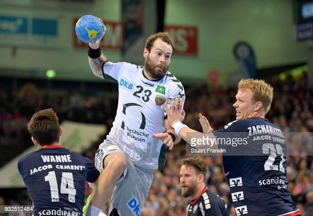 Anders Zachariassen of Flensburg challenges Steffen Faeth of Berlin during the DKB Bundesliga Handball match between SG FlensburgHandewitt and...