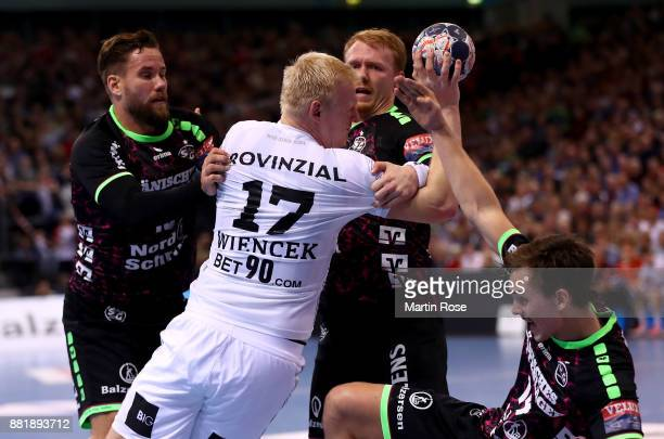 Anders Zachariassen of Flensburg Handewitt challenges Patrick Wiencek of Kiel for the ball during the Velux EHF Champions League match between SG...