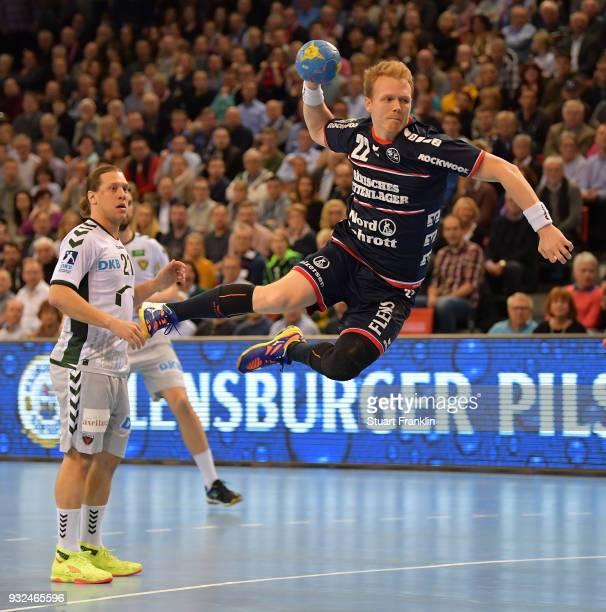 Anders Zachariassen of Flensburg scores a goal during the DKB Bundesliga Handball match between SG FlensburgHandewitt and Fuechse Berlin at...