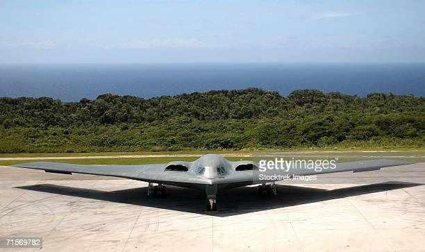 """andersen air force base, guam -- a b-2 spirit stealth bomber waits on the flightline here.  "" - stealth bomber stock photos and pictures"
