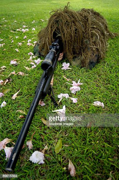 Andersen Air Force Base, Guam - Soldier practices sniper tactics during a run-through exercise.