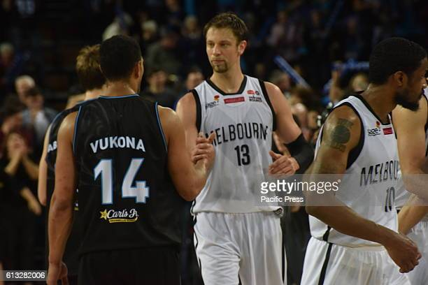 Andersen David of Melbourne United shakes hands with Vukona Mika of New Zealand Breaker after the round one NBL match between the New Zealand...