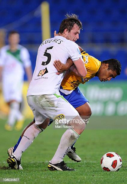 Anderson Alves Da Silva of Gold Coast contests for the ball with Mark Hughes of the Fury during the round 23 ALeague match between Gold Coast United...