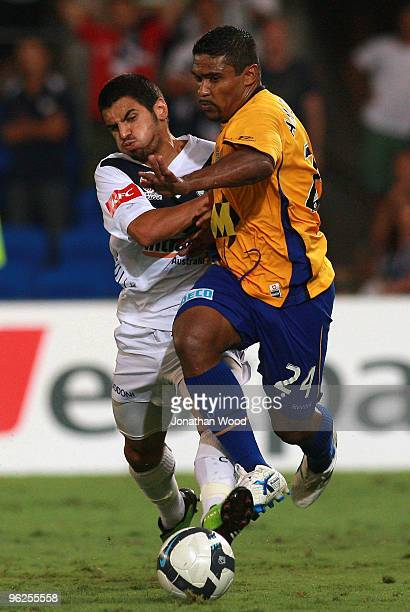 Anderson Alves Da Silva of the Gold Coast contests the ball with Surat Sukha of the Victory during the round 25 ALeague match between Gold Coast...
