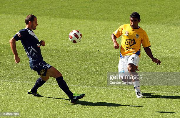 Anderson Alves Da Silva of the Gold Coast gets a pass away under pressure during the round 25 ALeague match between the Melbourne Victory and Gold...