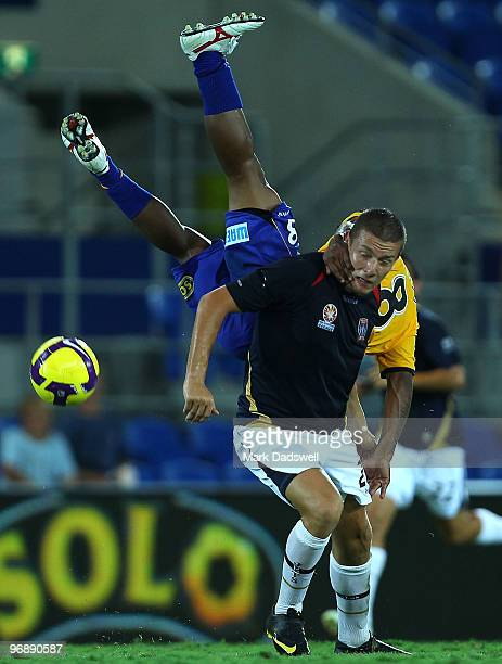 Anderson Alves Da Silva of United flies over Mirjan Pavlovic of the Jets during the ALeague semi final match between Gold Coast United and the...