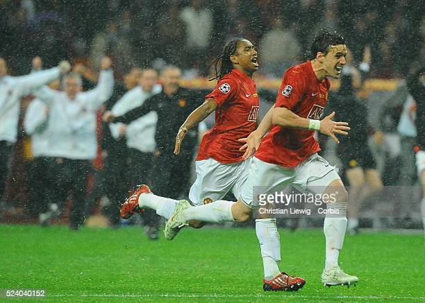 Anderson and Owen Hargreaves of Manchester running towards Edwin van der Sar after he safed the winning penalty during the UEFA Champions League...