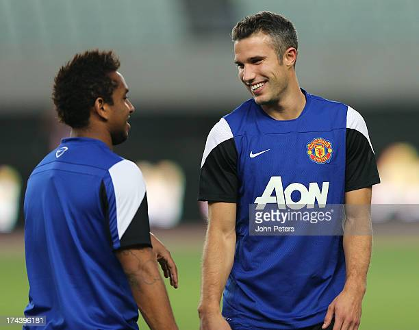Anderson and Robin van Persie of Manchester United in action during a first team training session as part of their preseason tour of Bangkok...