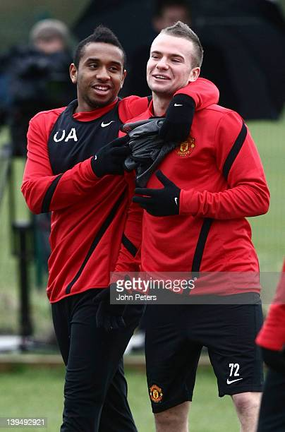 Anderson and Tom Cleverley of Manchester United in action during a first team training session ahead of their UEFA Europa League round of 32 second...