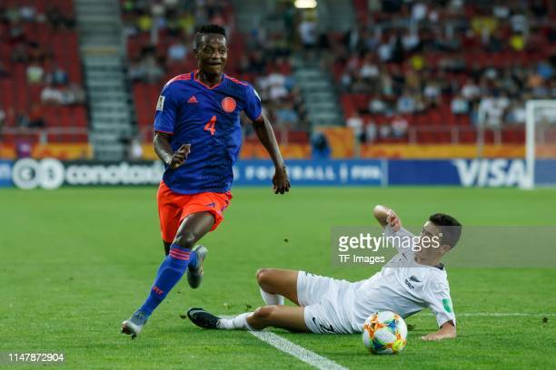Anderson Arroyo of Colombia and Dalton Wilkins of New Zealand battle for the ball during the 2019 FIFA U20 World Cup Round of 16 match between...