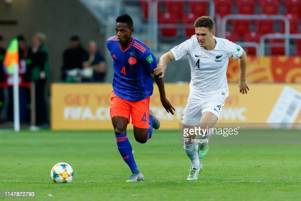 Anderson Arroyo of Colombia and Gianni Stensness of New Zealand battle for the ball during the 2019 FIFA U20 World Cup Round of 16 match between...