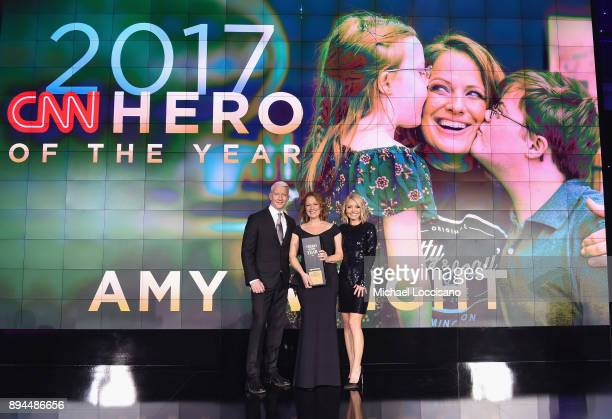 Anderson Cooper 2017 CNN Hero of the year Amy Wright and Kelly Ripa pose onstage during CNN Heroes 2017 at the American Museum of Natural History on...