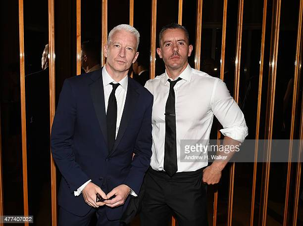 Anderson Cooper and Benjamin Maisani attend the 2015 amfAR Inspiration Gala New York after party at Boom Boom Room on June 16 2015 in New York City