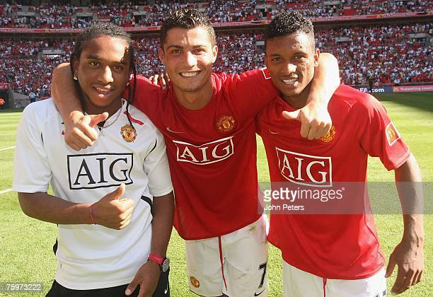 Anderson Cristiano Ronaldo and Nani of Manchester United celebrate after winning the Community Shield preseason friendly match between Chelsea and...