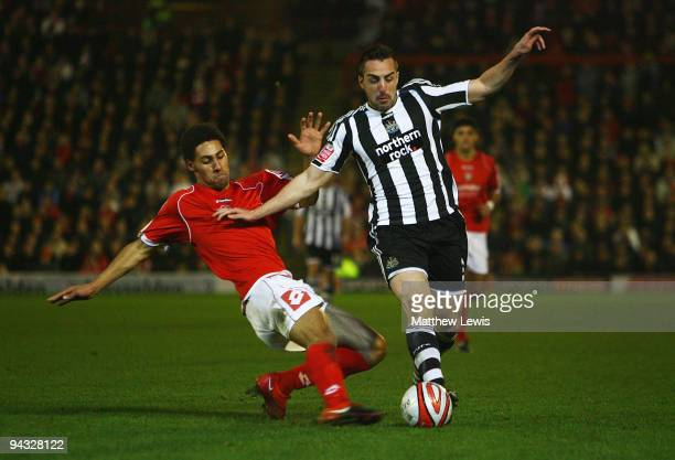 Anderson De Silva of Barnsley tackles Jose Enrique of Newcastle in action during the CocaCola Championship match between Barnsley and Newcastle...