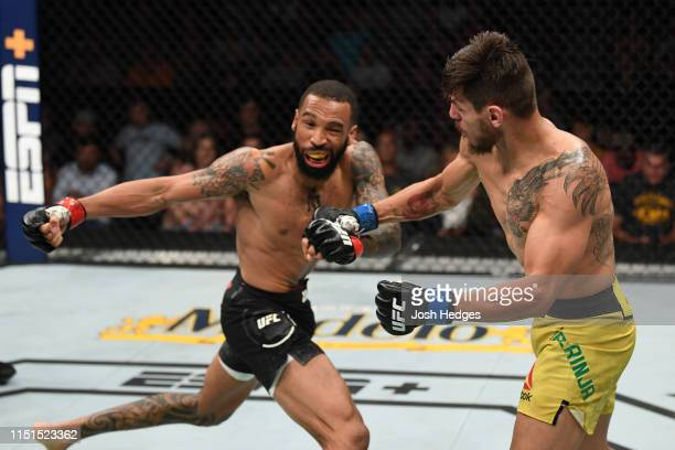 Anderson dos Santos of Brazil punches Andre Ewell in their bantamweight bout during the UFC Fight Night event at Bon Secours Wellness Arena on June...
