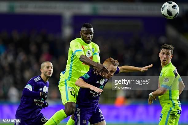 Anderson Esiti midfielder of KAA Gent jumps over Sofiane Hanni midfielder of RSC Anderlecht to reach the ball during the Jupiler Pro League match...