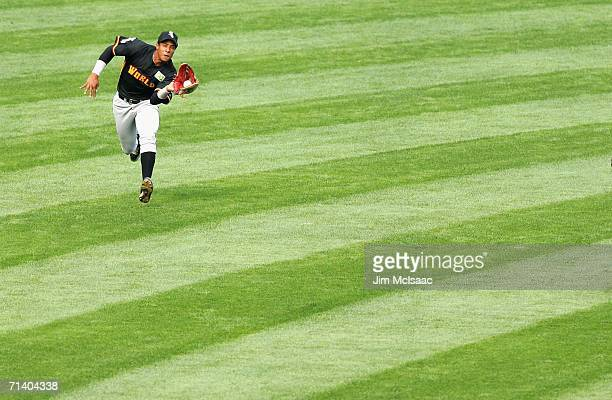 Anderson Gomes of the World Team makes a catch against the U.S.A. Team during the XM Satellite Radio All-Star Futures Game at PNC Park on July 9,...