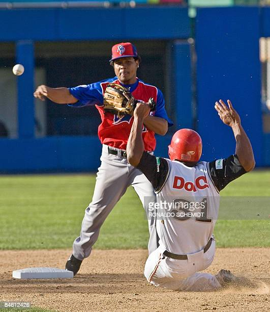 Anderson Hernandez of Tigres del Licey of Dominican Republic puts out Jorge Padilla of Leones de Ponce of Puerto Rico during the Baseball Caribbean...