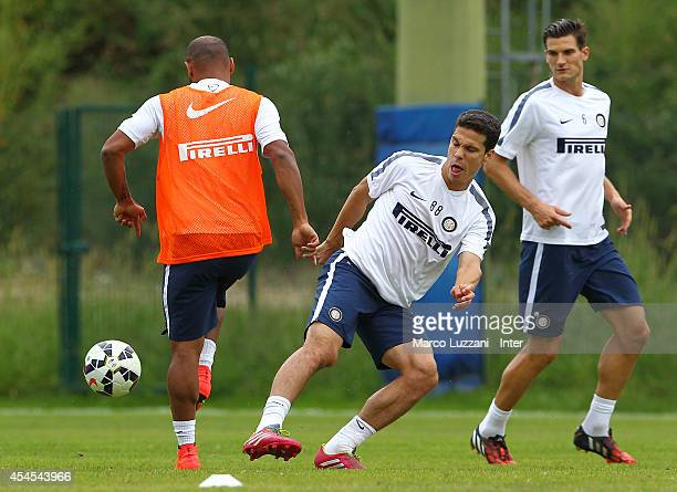 Anderson Hernanes competes with Cicero Moreira Jonathan during FC Internazionale training session at the club's training ground on September 3 2014...