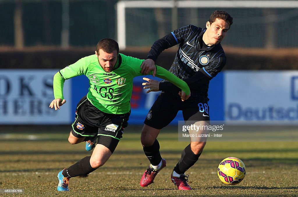 Anderson Hernanes (R) of FC Internazionale Milano competes for the ball during FC Internazionale training session at the club's training ground on February 11, 2015 in Como, Italy.