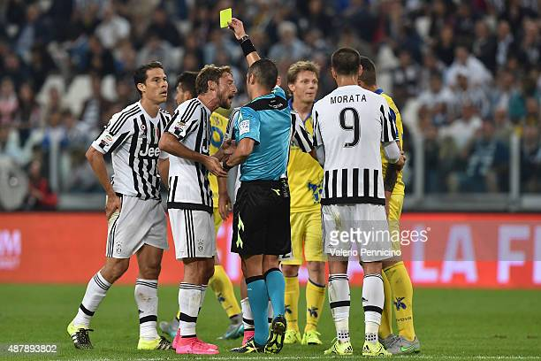 Anderson Hernanes of Juventus FC receives the yellow card from referee Marco Guida during the Serie A match between Juventus FC and AC Chievo Verona...