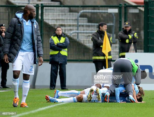 Anderson Hernanes of SS Lazio is mobbed by team mates after scoring his team's third goal of the game during the Serie A match between Udinese Calcio...