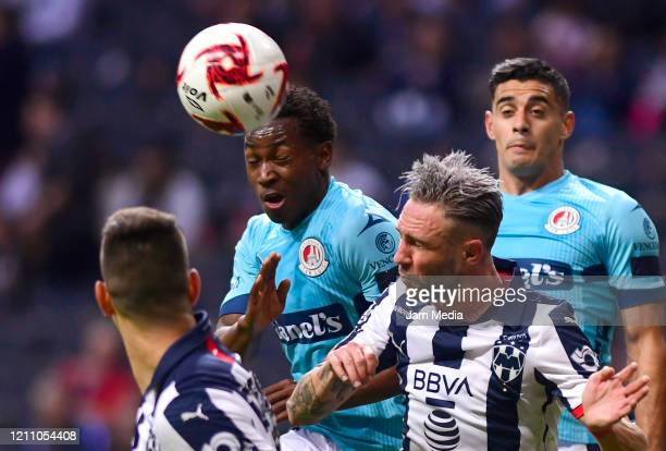 Anderson Julio of San Luis fights for the ball with Miguel Layun of Monterrey during the 9th round match between Monterrey and Atletico San Luis as...