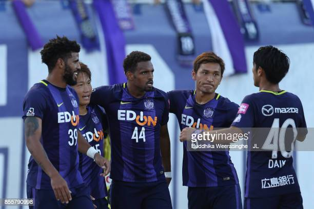 Anderson Lopes of Sanfrecce Hiroshima celebrates scoring the opening goal with his team mates during the JLeague J1 match between Sanfrecce Hiroshima...
