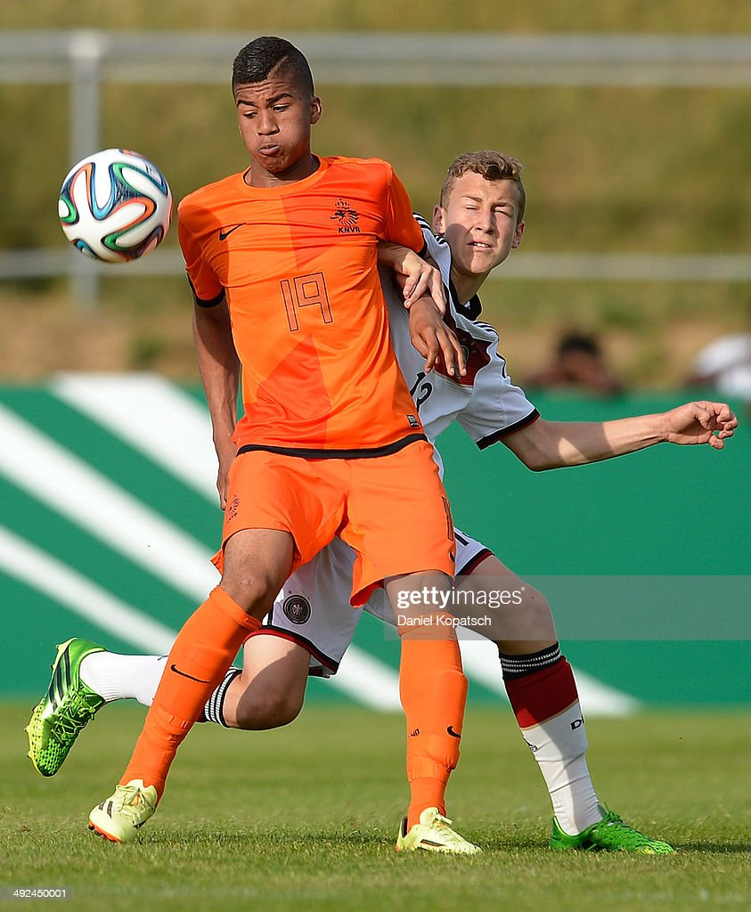 Anderson Lopez of the Netherlands (L) is challenged by David Groezinger of Germany during the international friendly U15 match between Germany and Netherlands on May 20, 2014 in Weingarten, Germany.