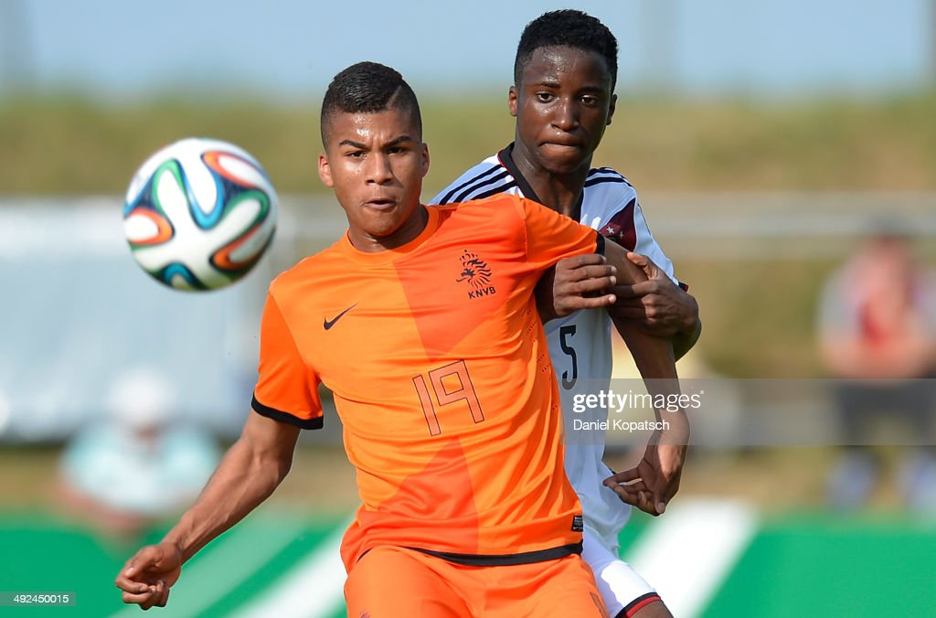 Anderson Lopez of the Netherlands (L) is challenged by Panzu Ernesto of Germany during the international friendly U15 match between Germany and Netherlands on May 20, 2014 in Weingarten, Germany.