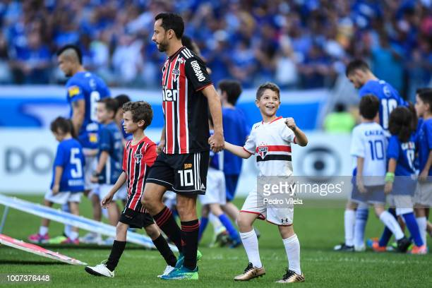 Anderson Luiz de Carvalho of Sao Paulo enters into the field with two boys before the match between Cruzeiro and Sao Paulo as part of Brasileirao...